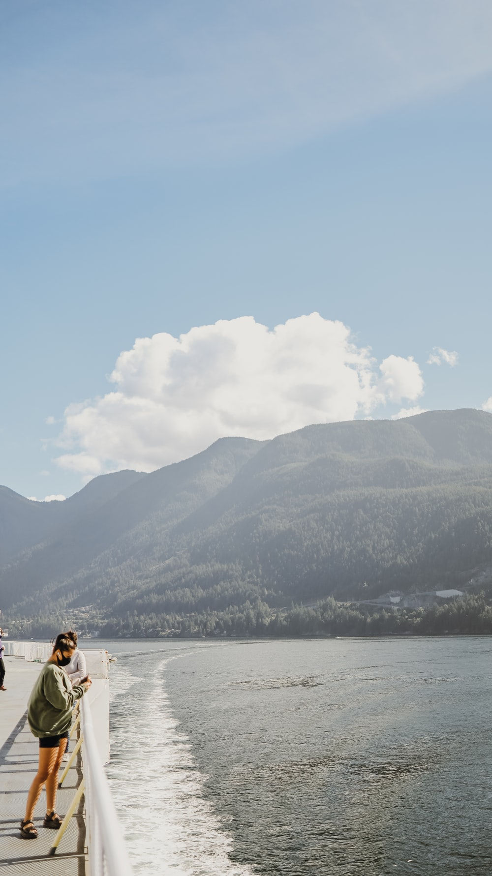 2 person sitting on white boat on sea during daytime
