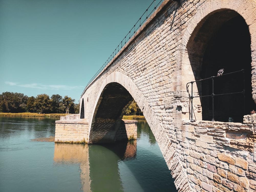 brown brick bridge over river