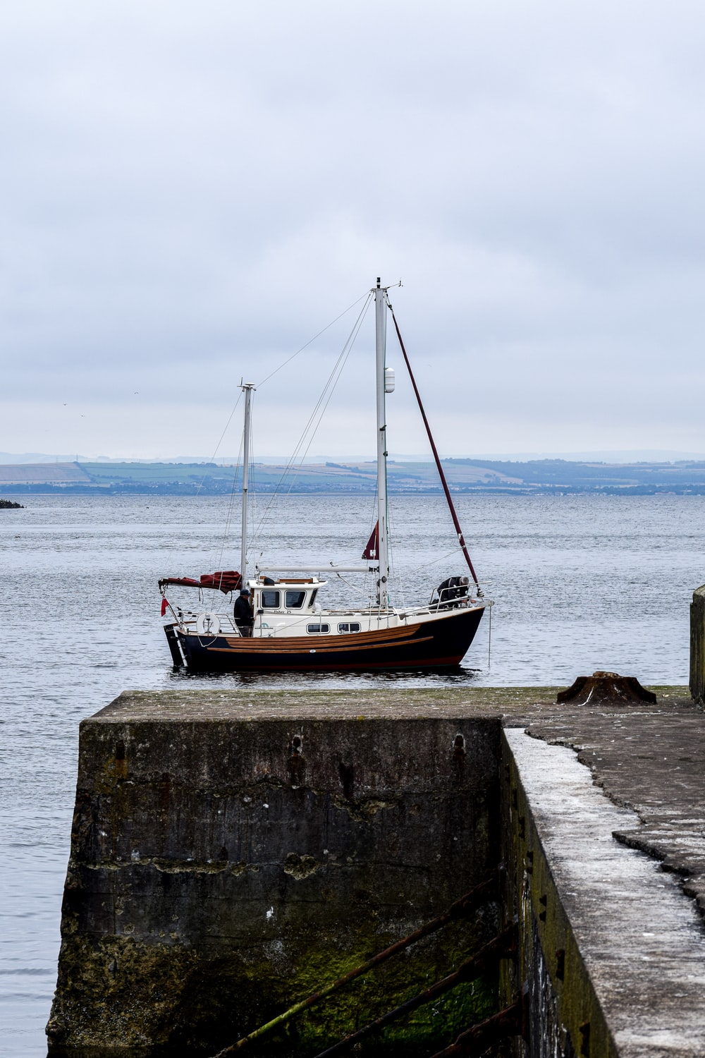 brown and white boat on sea dock during daytime