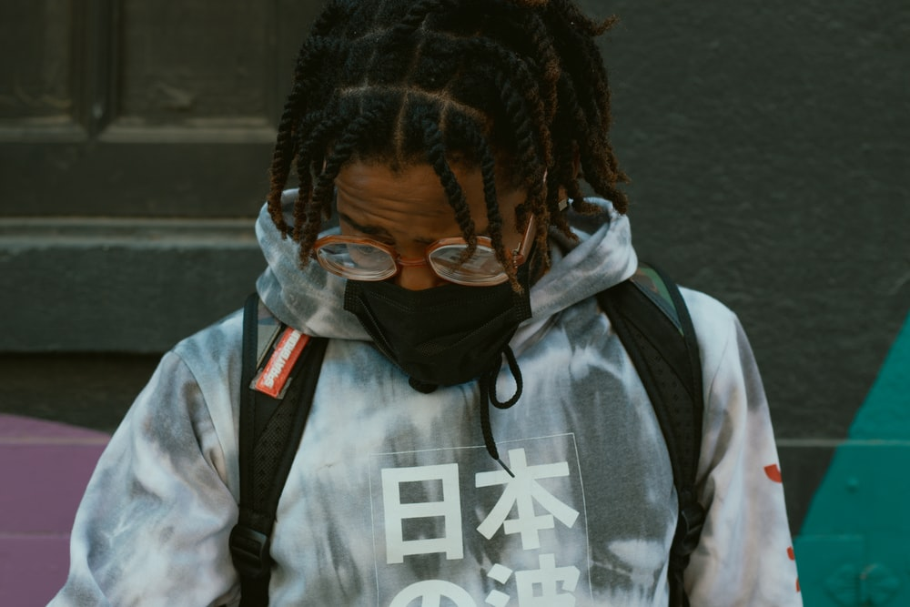 man in gray and black jacket wearing black framed eyeglasses