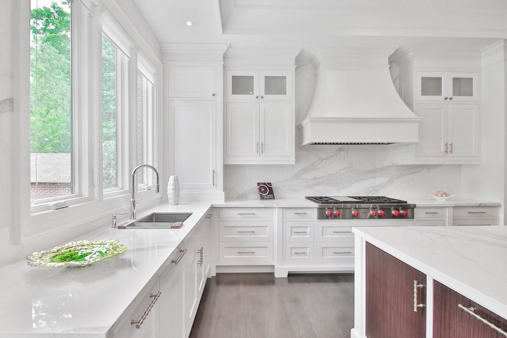 white wooden kitchen cabinet and sink