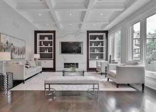 white wooden coffee table near white sofa