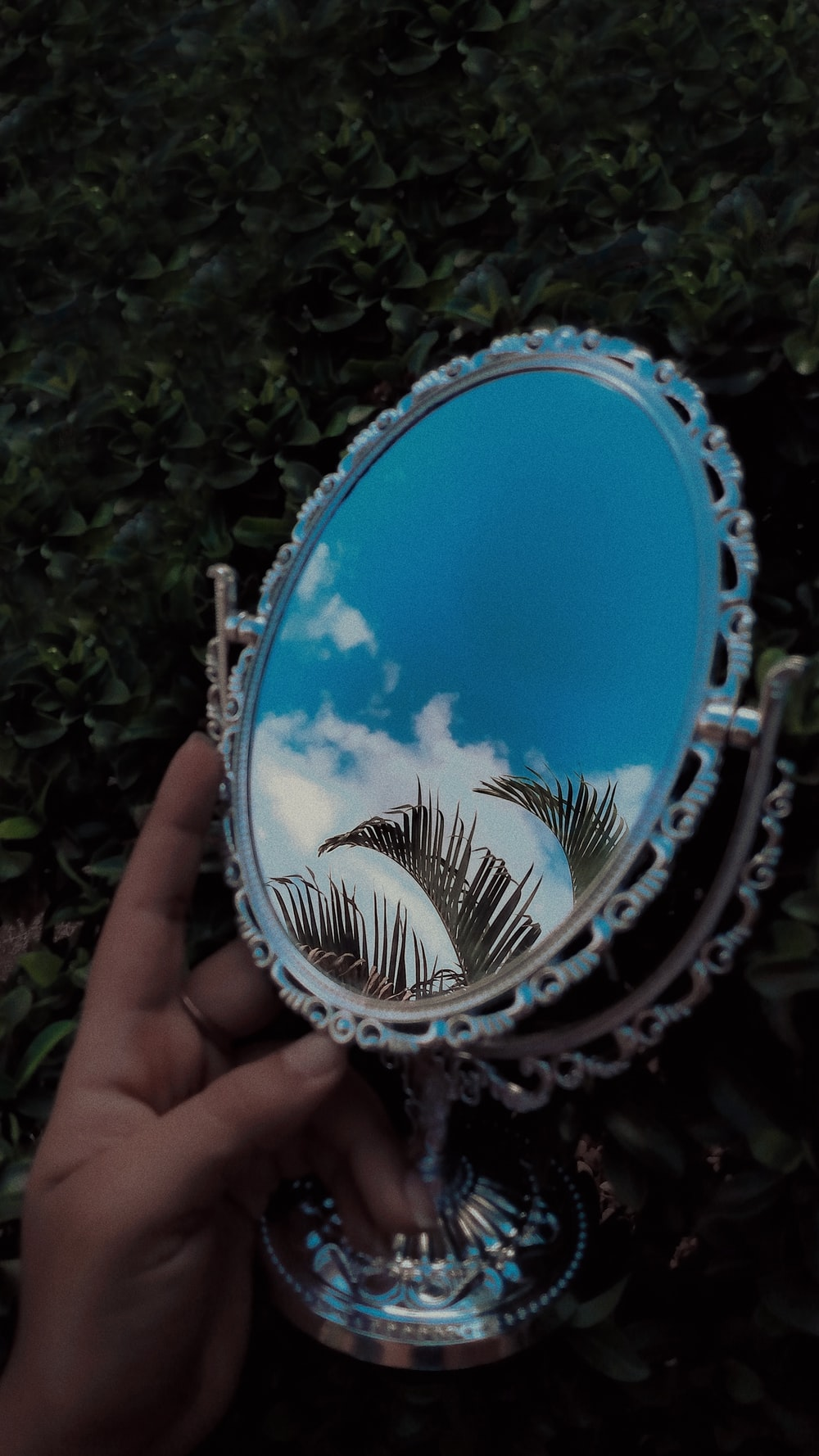 blue and silver round mirror