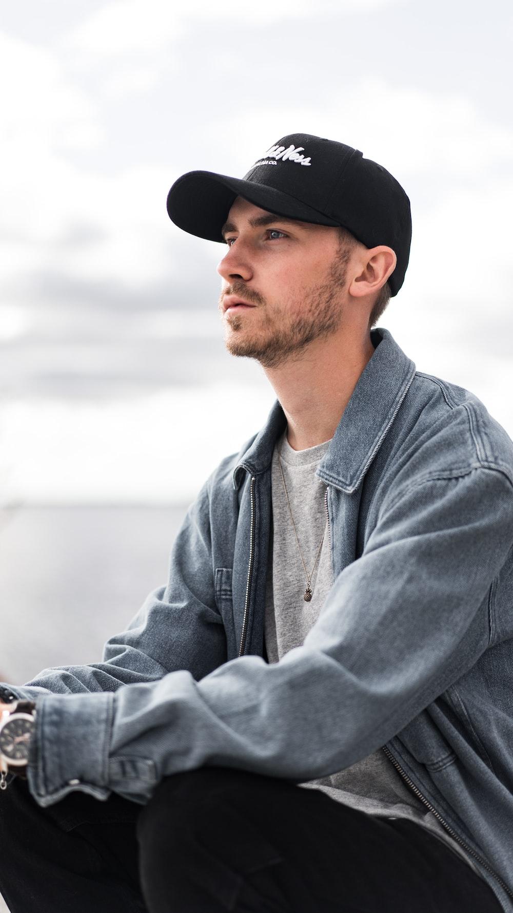 man in gray zip up jacket and black cap