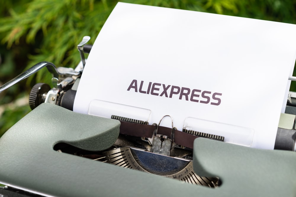 white and black typewriter on green grass during daytime