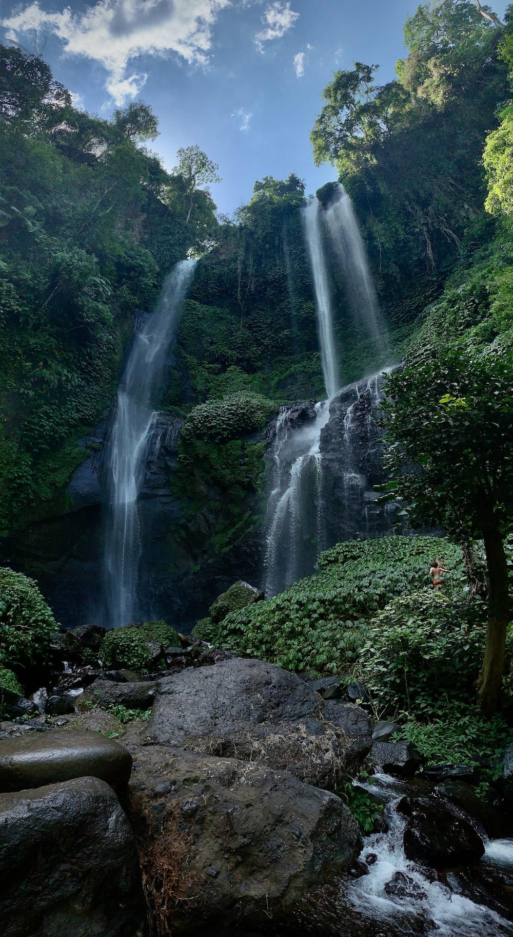 waterfalls on rocky ground during daytime