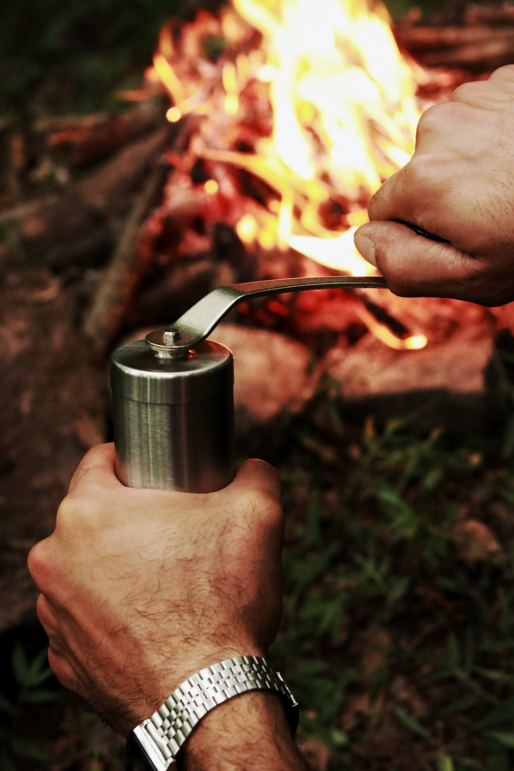 person holding stainless steel vacuum flask