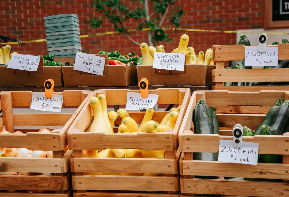 yellow and green vegetables on brown wooden crate