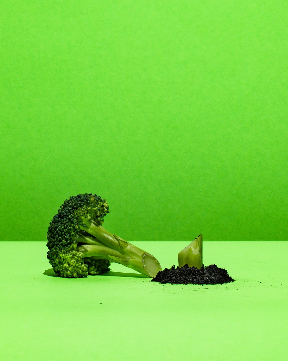 green broccoli on white paper