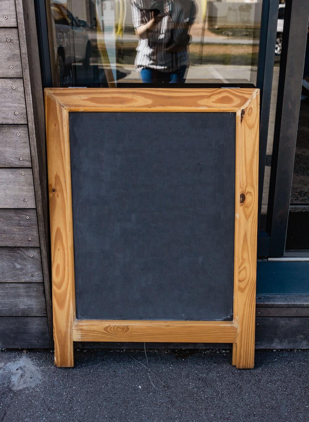 brown wooden framed black board