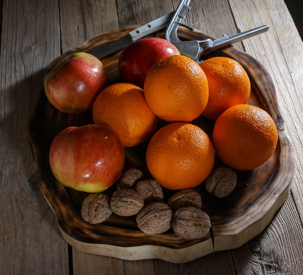 orange fruits on brown wooden tray
