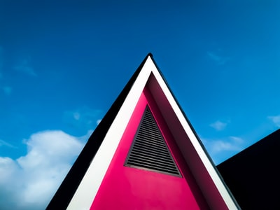 red and black concrete building under blue sky during daytime