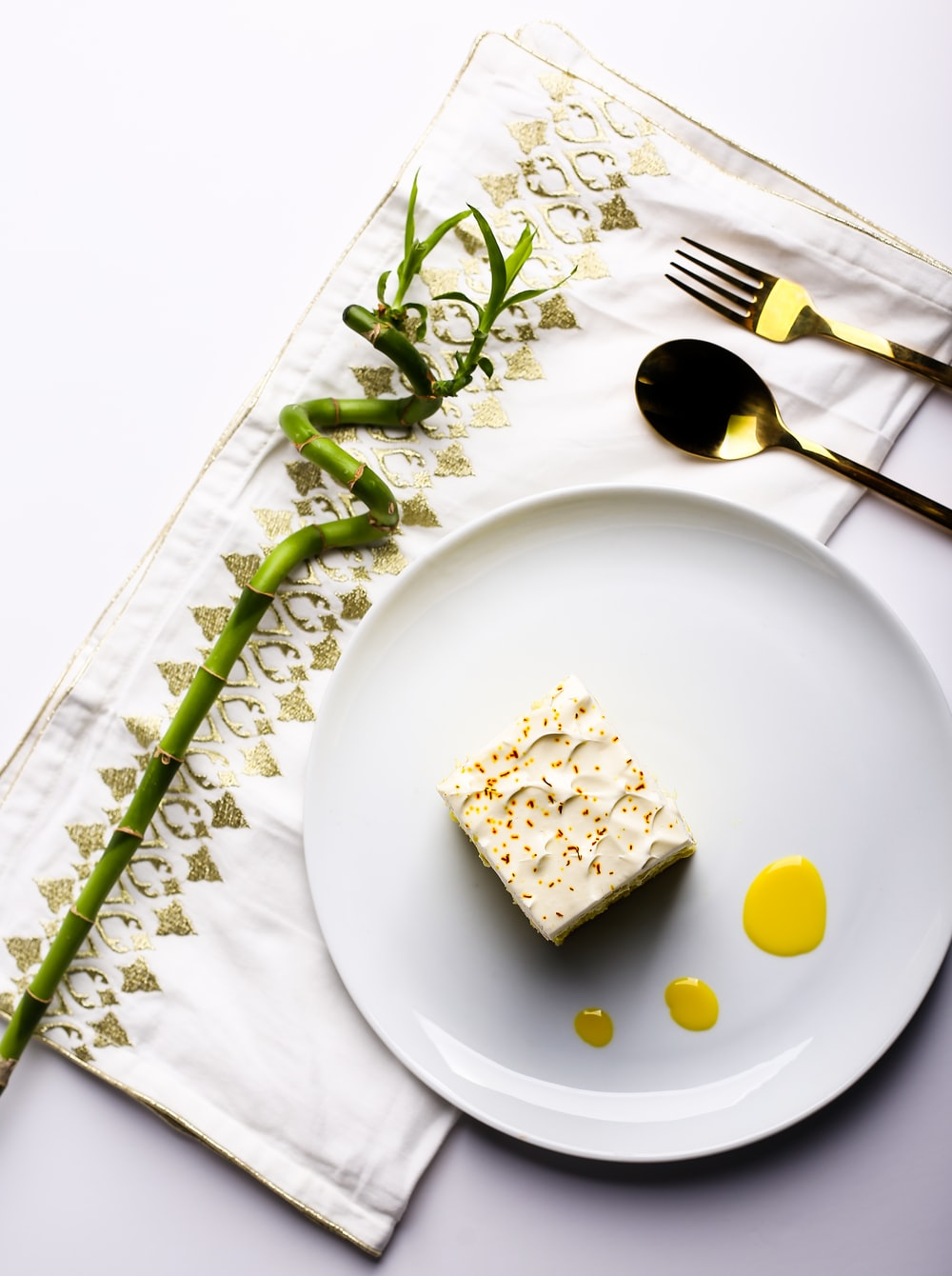 white ceramic plate with green vegetable