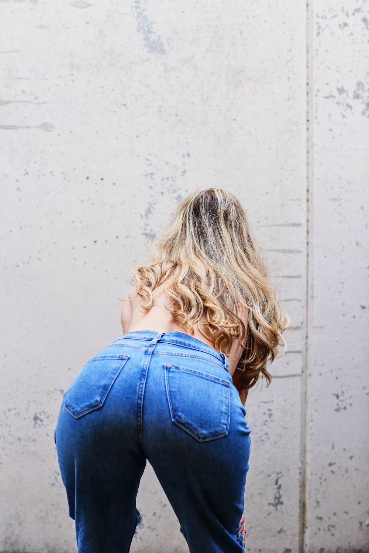 blonde haired girl in blue denim jacket and blue denim jeans
