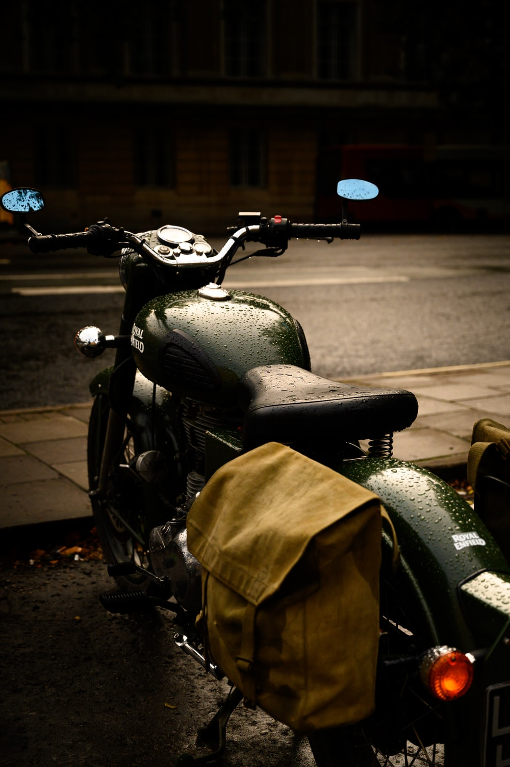 black motorcycle with brown textile on top