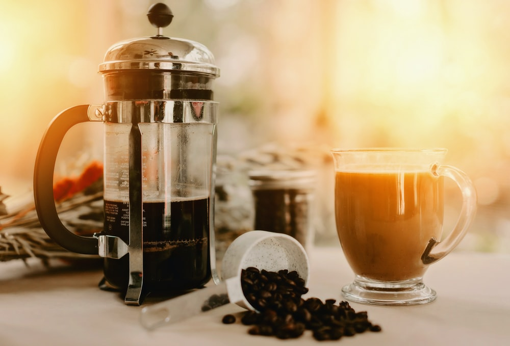 clear glass jar with coffee beans