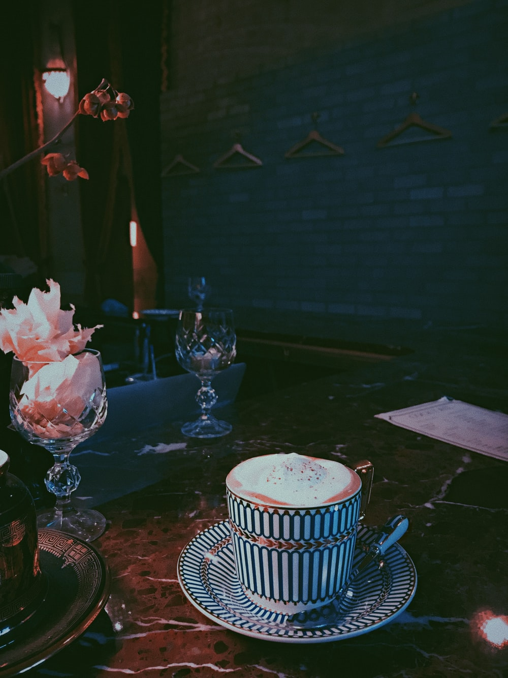 white and black ceramic mug on table