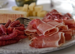 raw meat on white ceramic plate