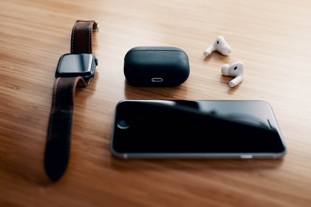 black and silver apple watch on brown wooden table
