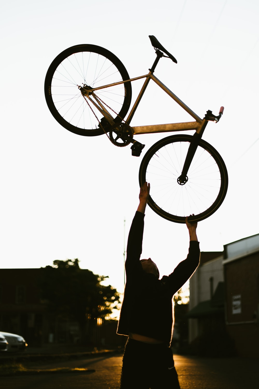 silhouette of person riding on bicycle