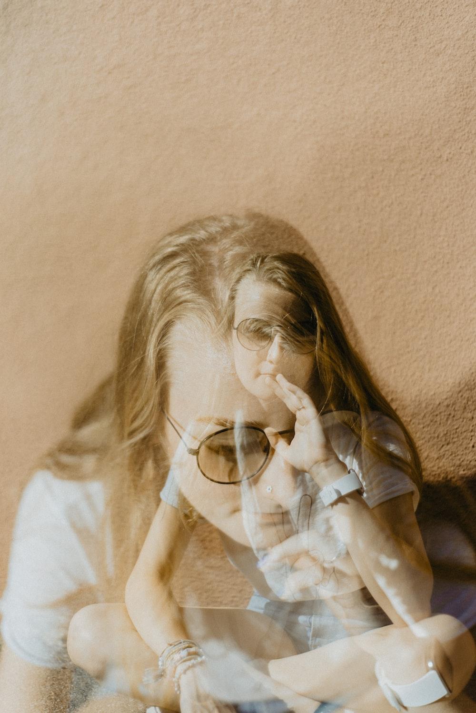 woman in white shirt wearing eyeglasses