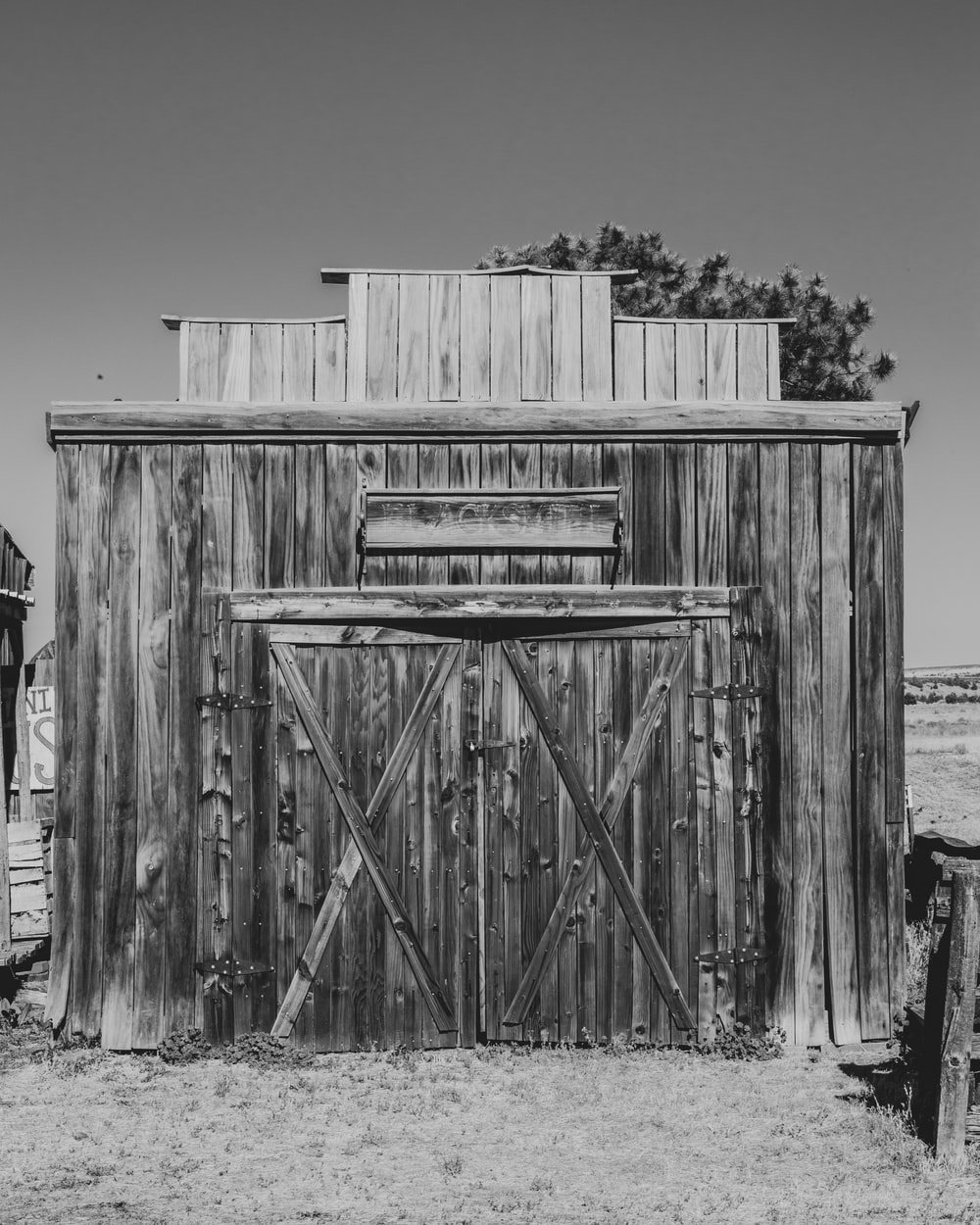 grayscale photo of wooden fence
