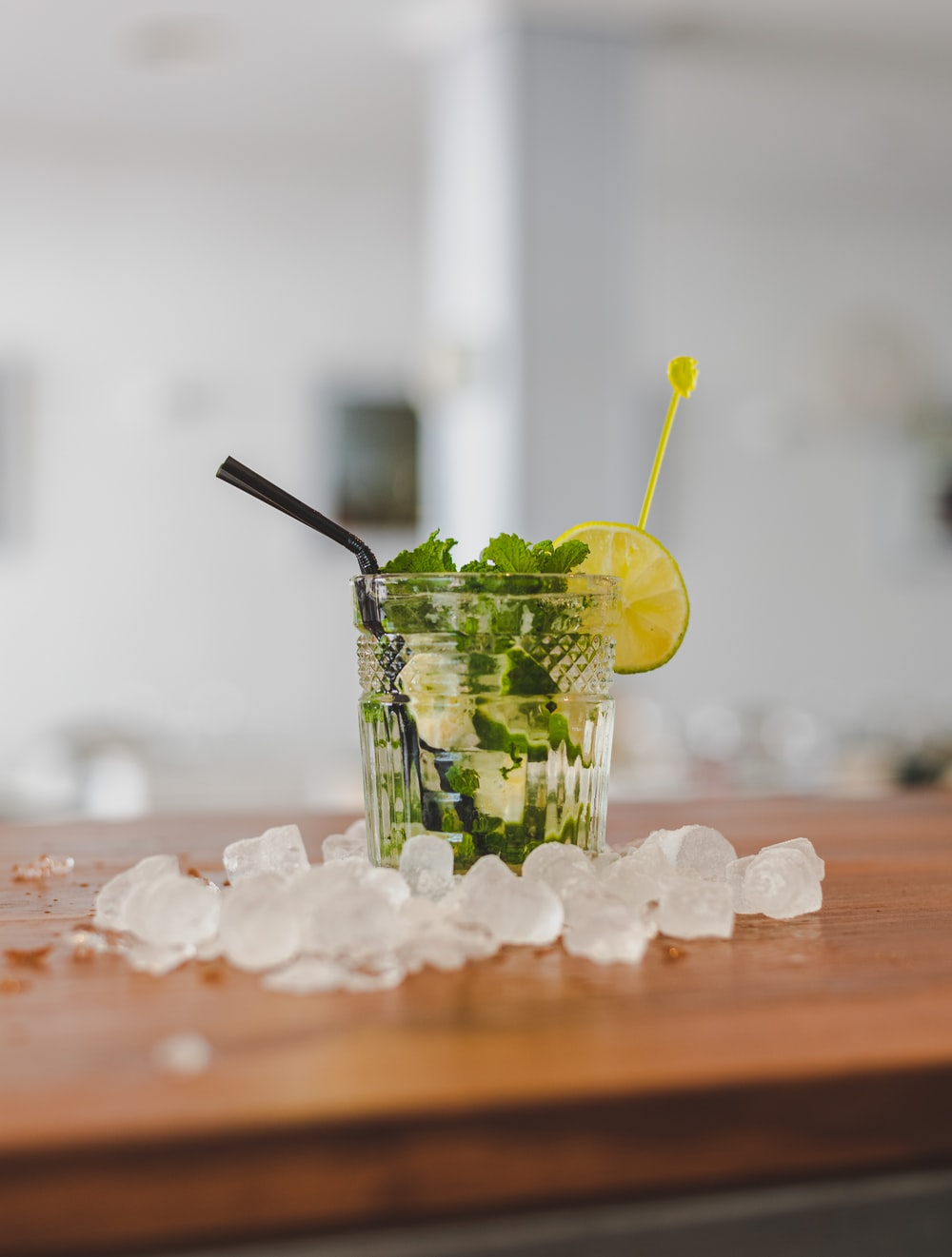 clear drinking glass with green leaf