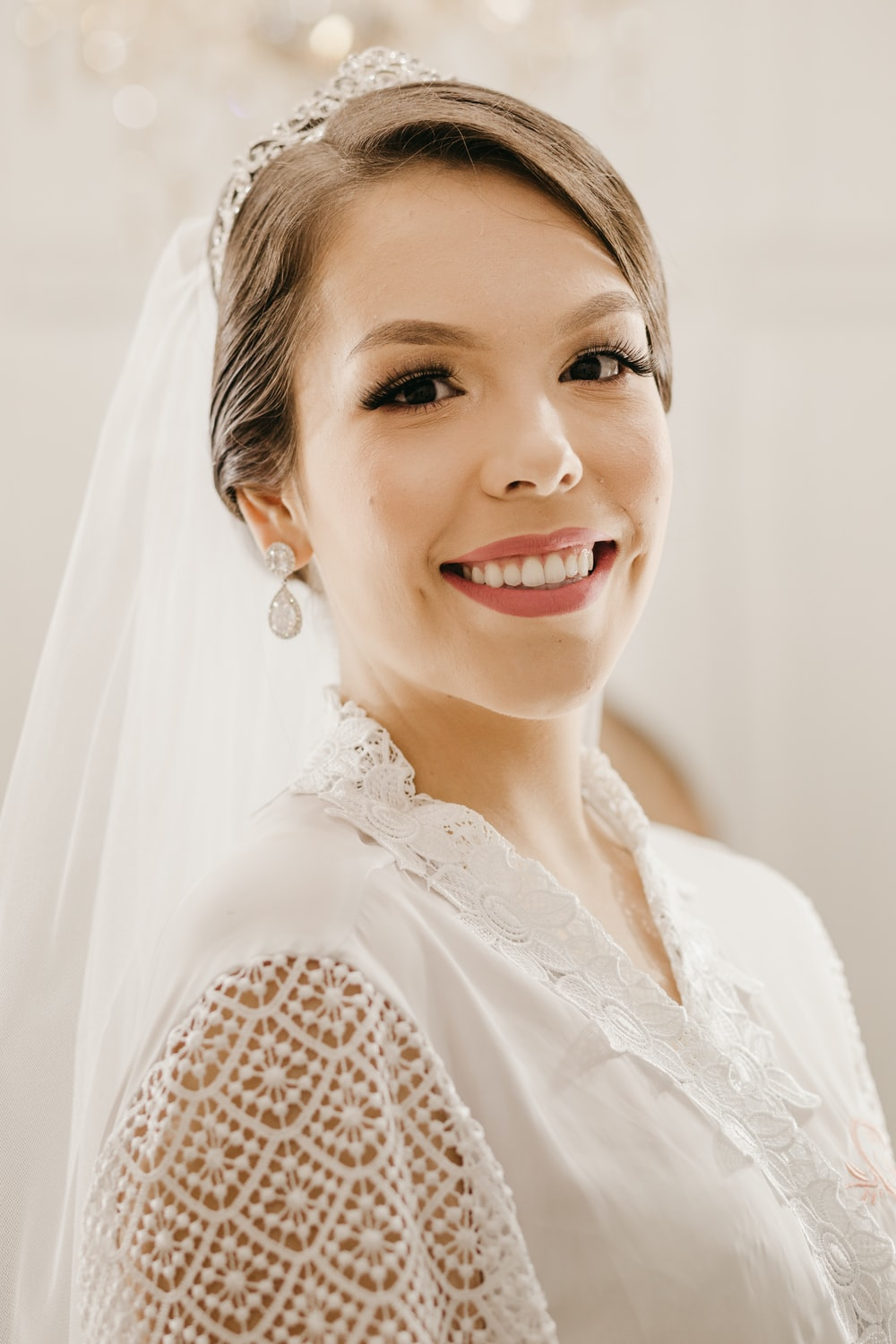 woman in white lace shirt