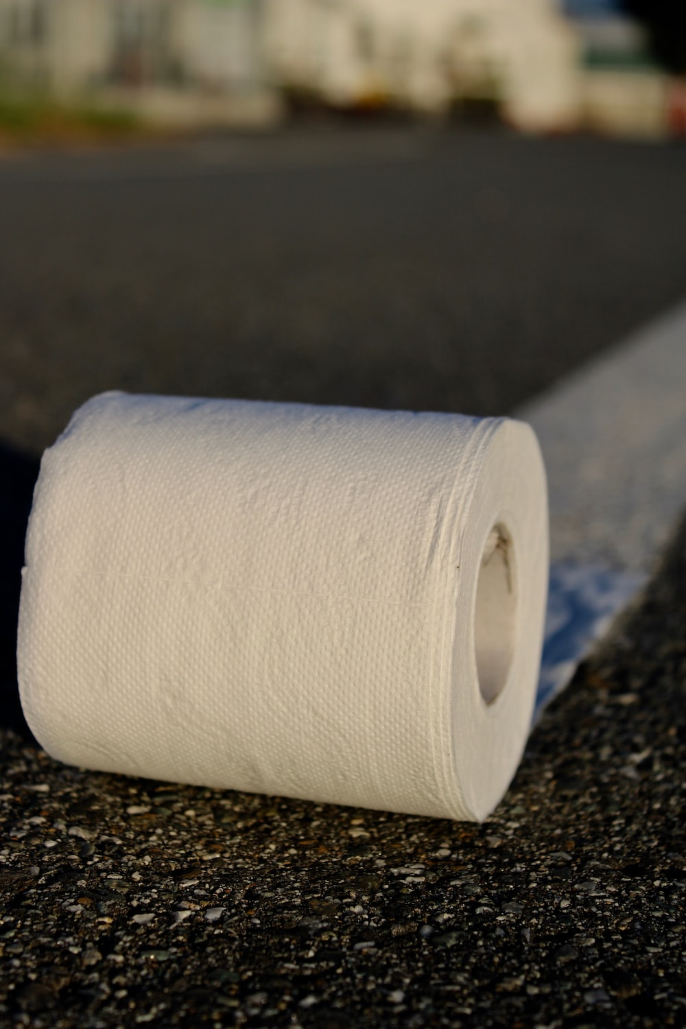 white toilet paper roll on black marble table