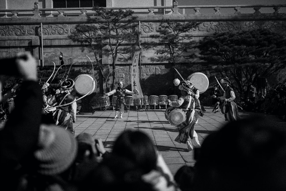 grayscale photo of people playing musical instruments