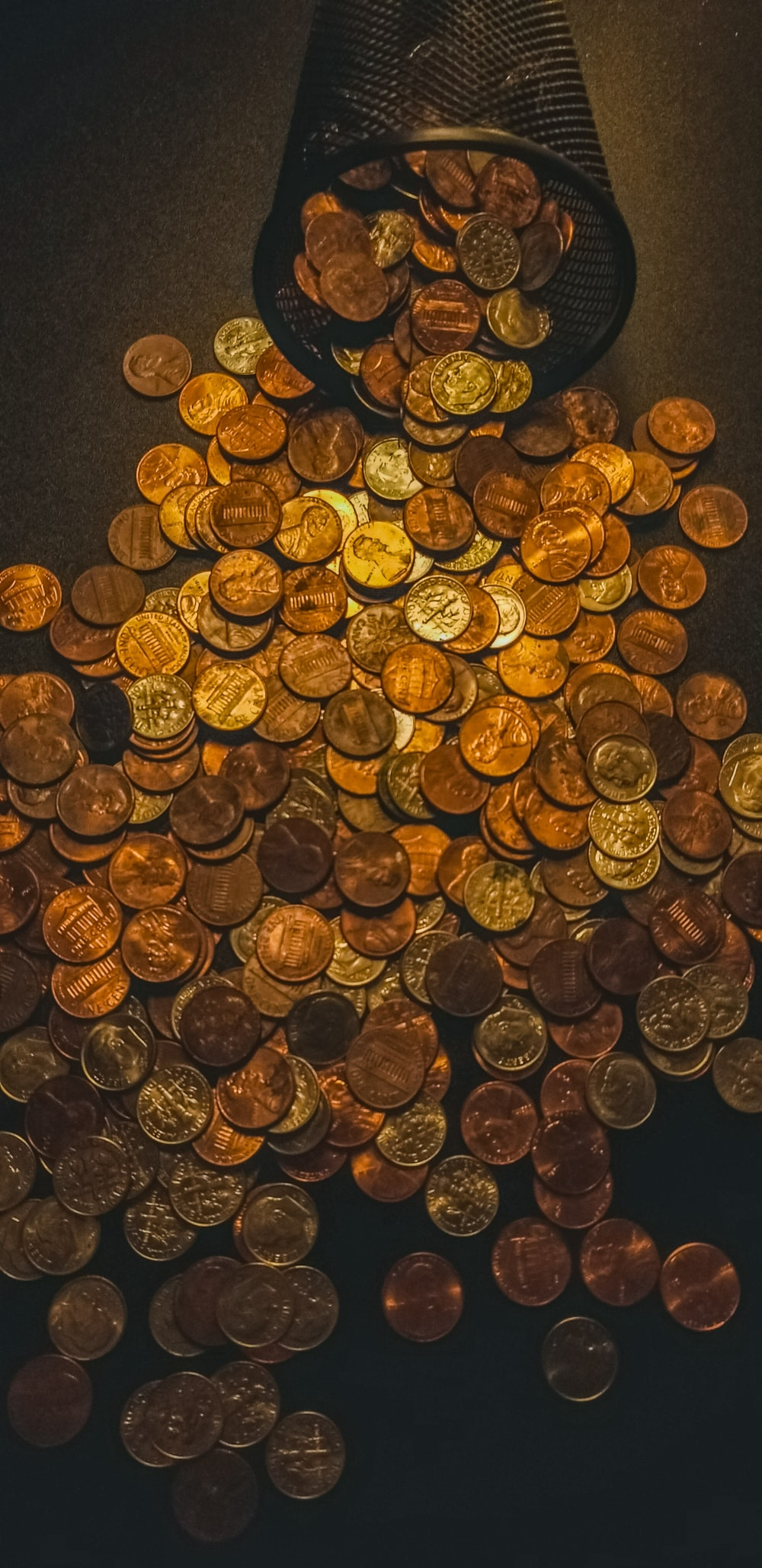 gold round coins on black textile