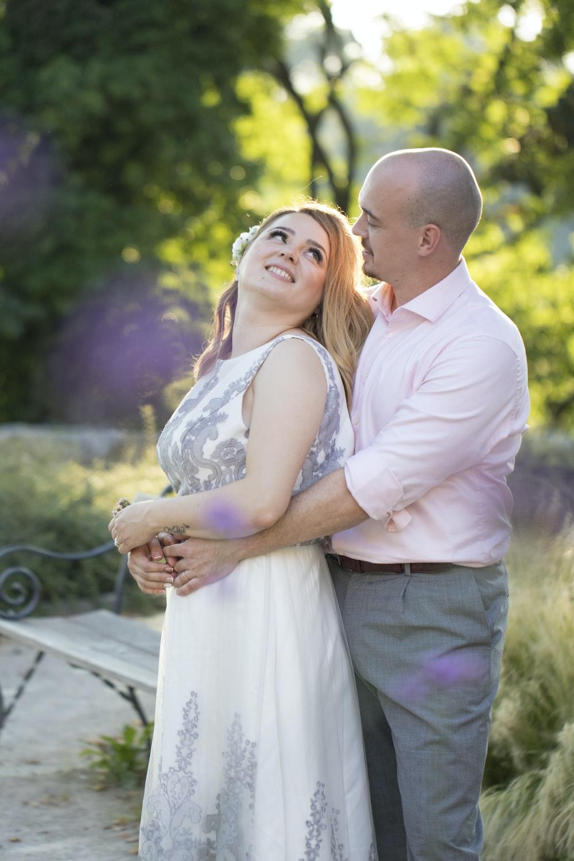 man in white dress shirt kissing woman in white dress