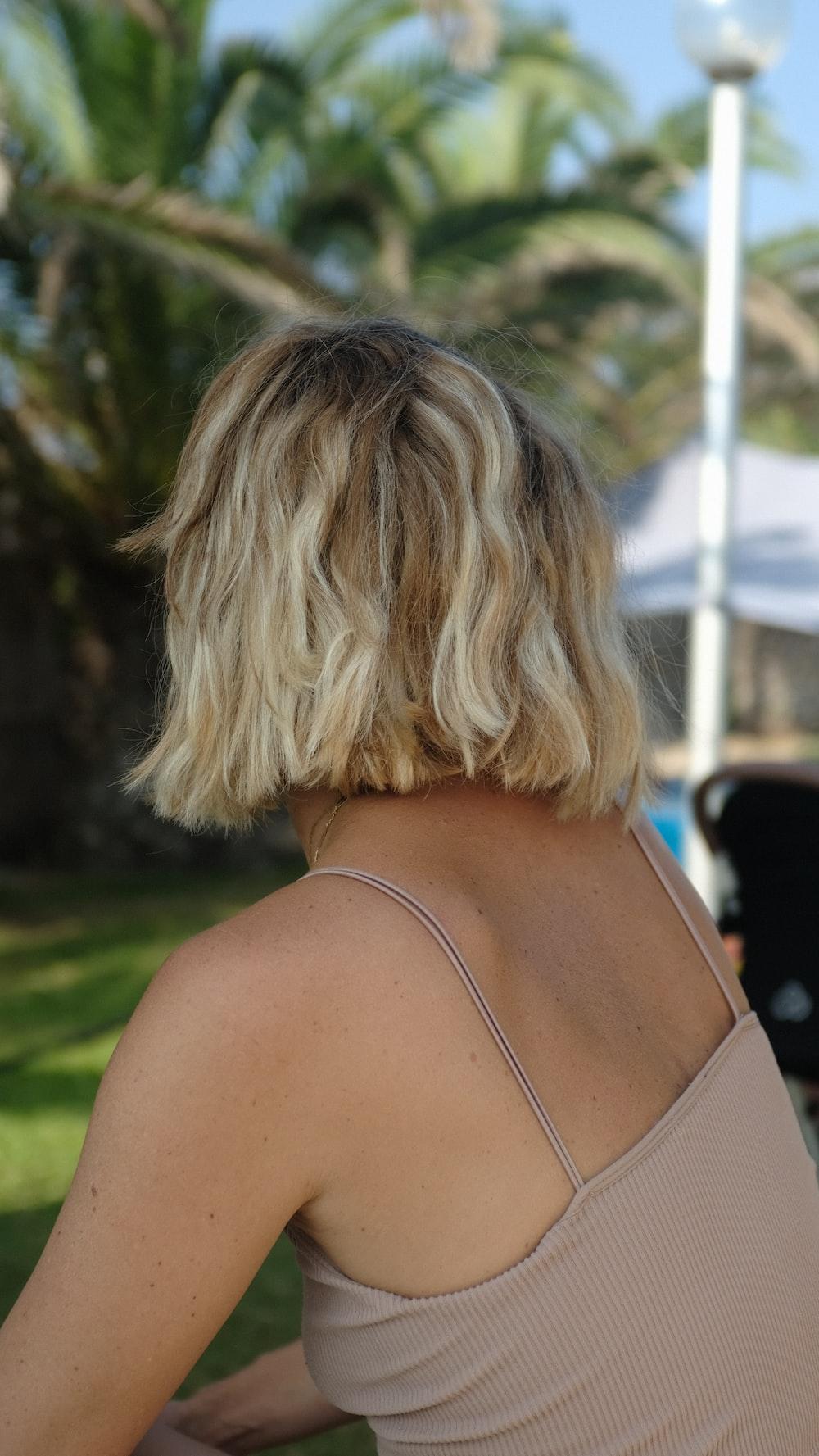 woman in brown spaghetti strap top