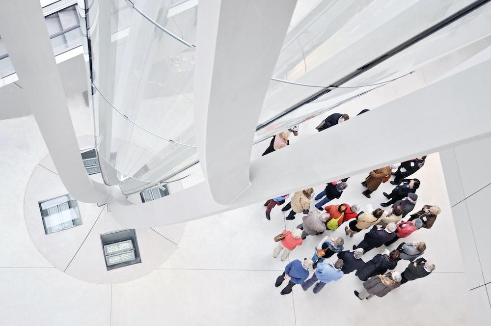 people sitting on white tiled floor