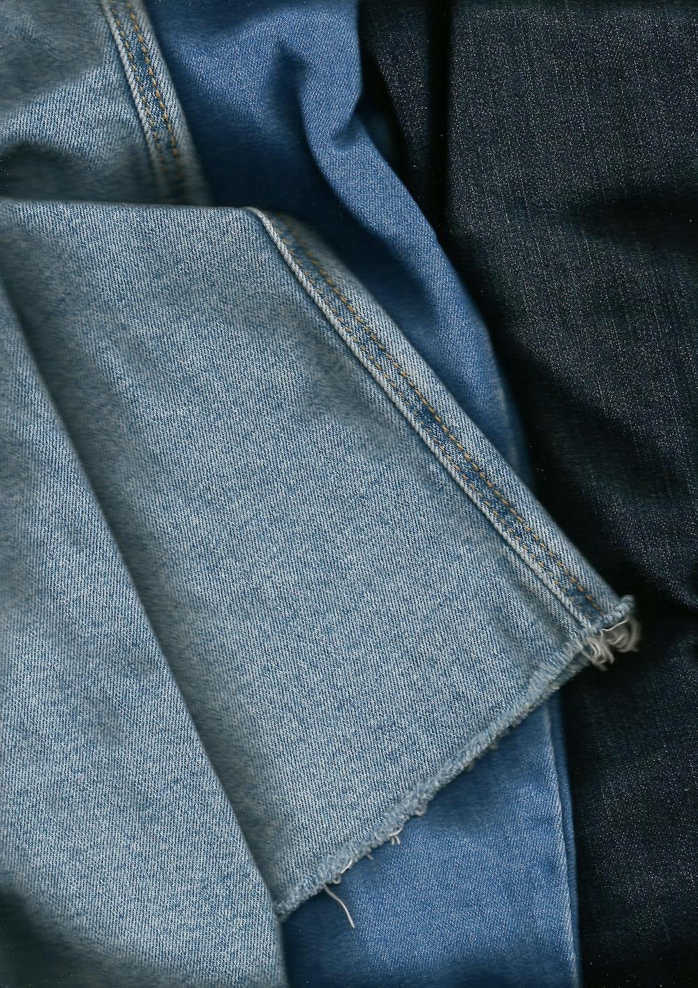 blue denim textile on black textile