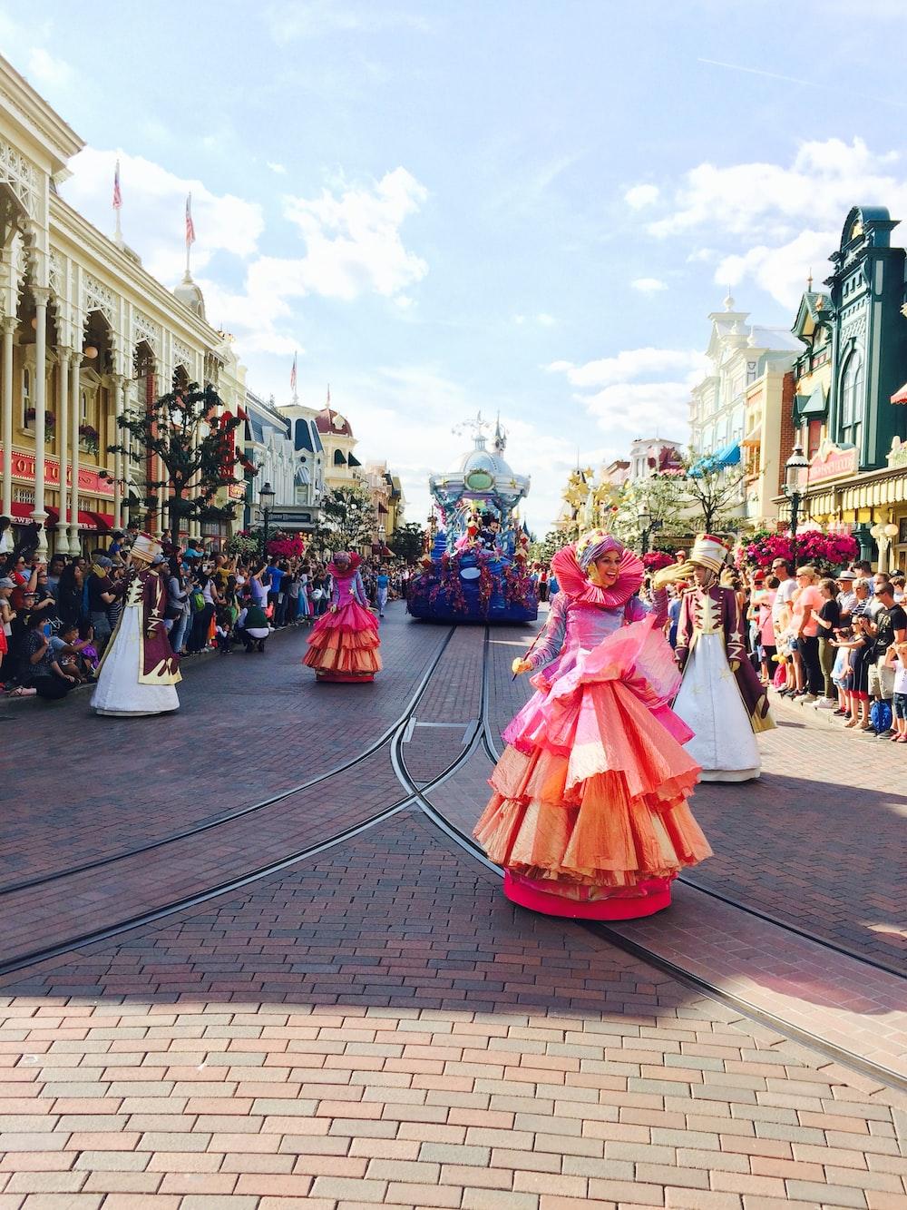 woman in pink dress walking on street during daytime