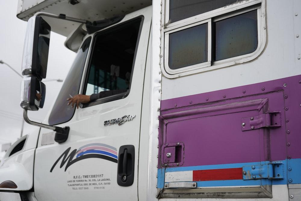 white and pink van during daytime
