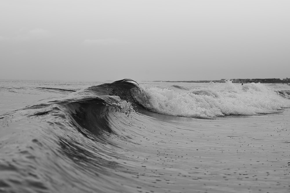 grayscale photo of sea waves