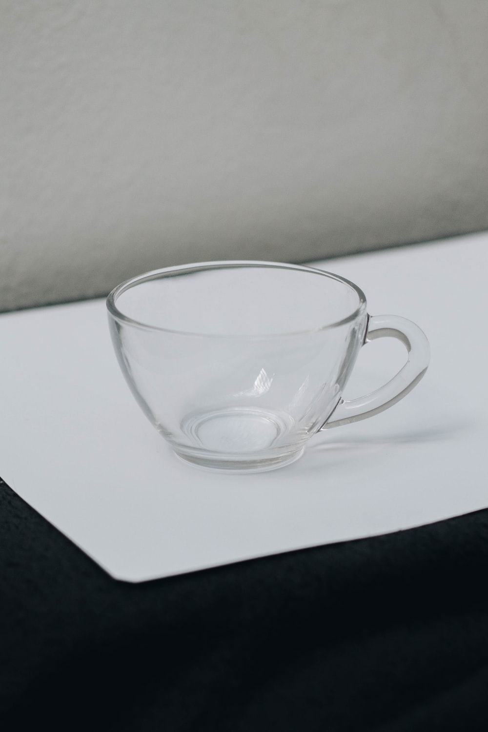 clear glass cup on white tissue paper