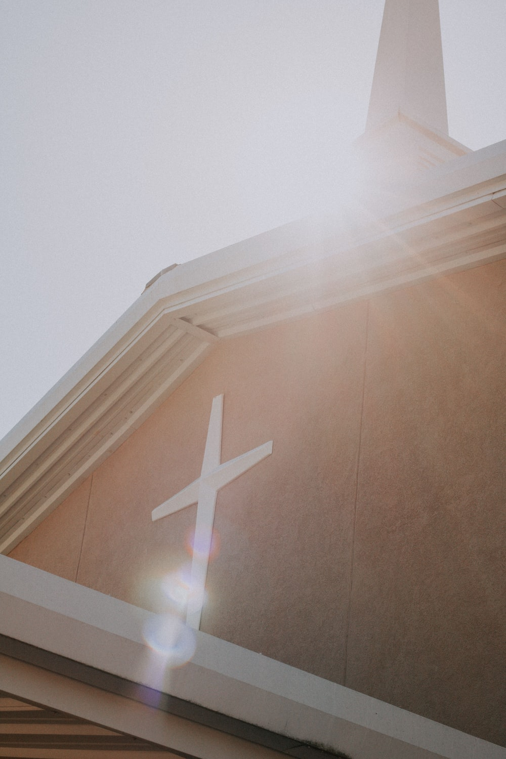 white cross on brown wall
