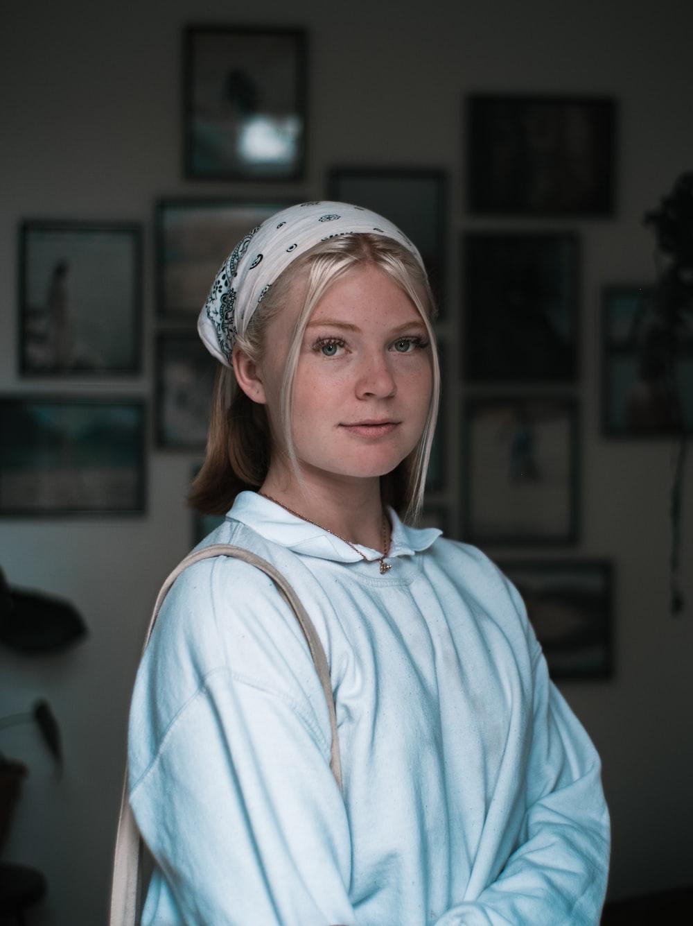 woman in white shirt wearing white head band