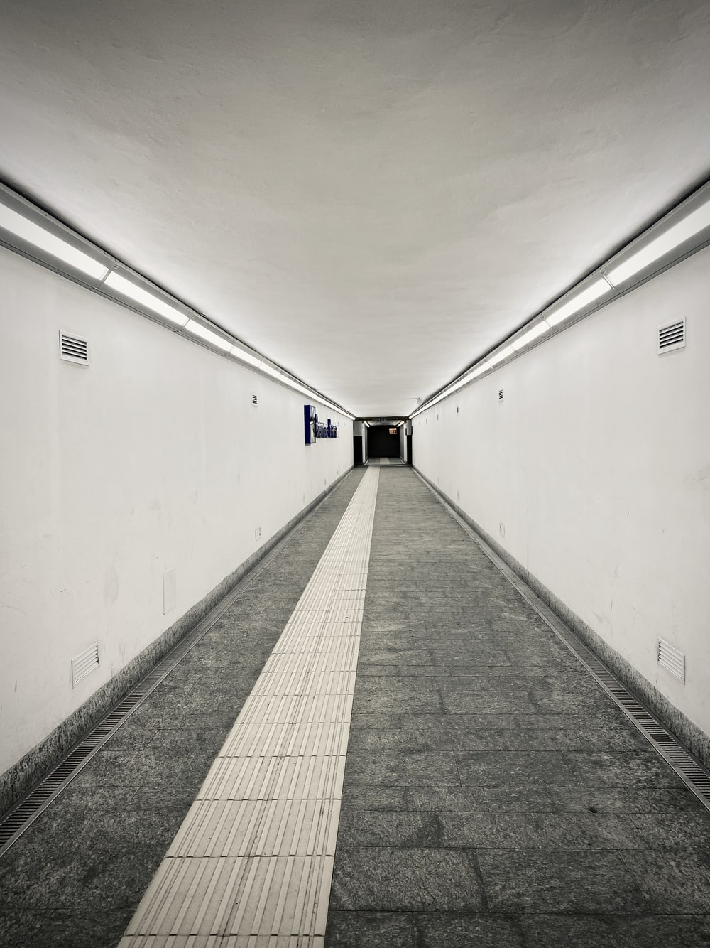 white and gray hallway with white walls
