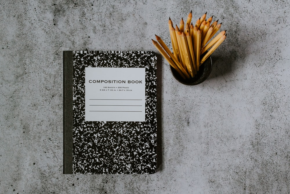 black and white book on gray marble table