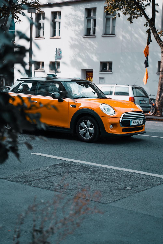 orange chevrolet camaro on road during daytime