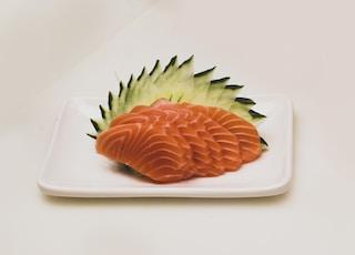 sliced fruit on white ceramic plate