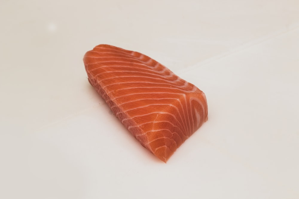 sliced fish meat on white surface