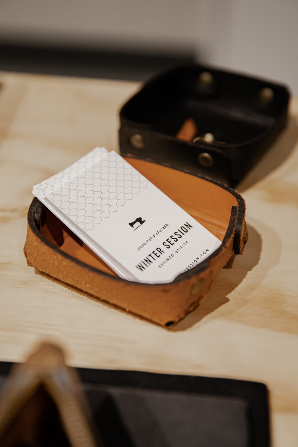 white and black checked card on brown wooden table