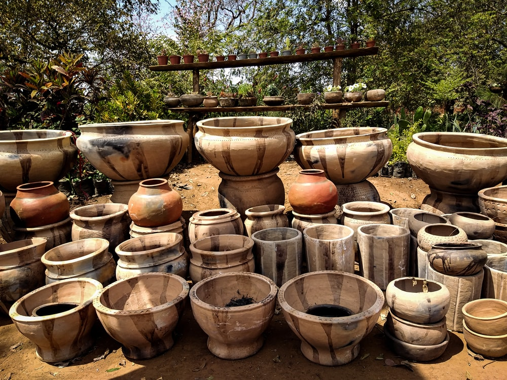 brown clay pots on brown soil