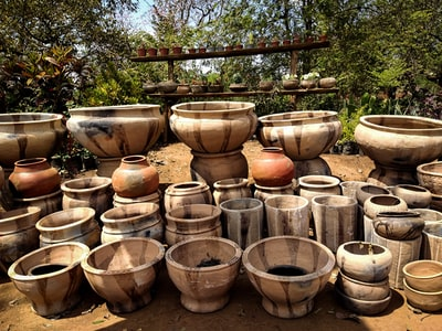brown clay pots on brown soil malawi teams background