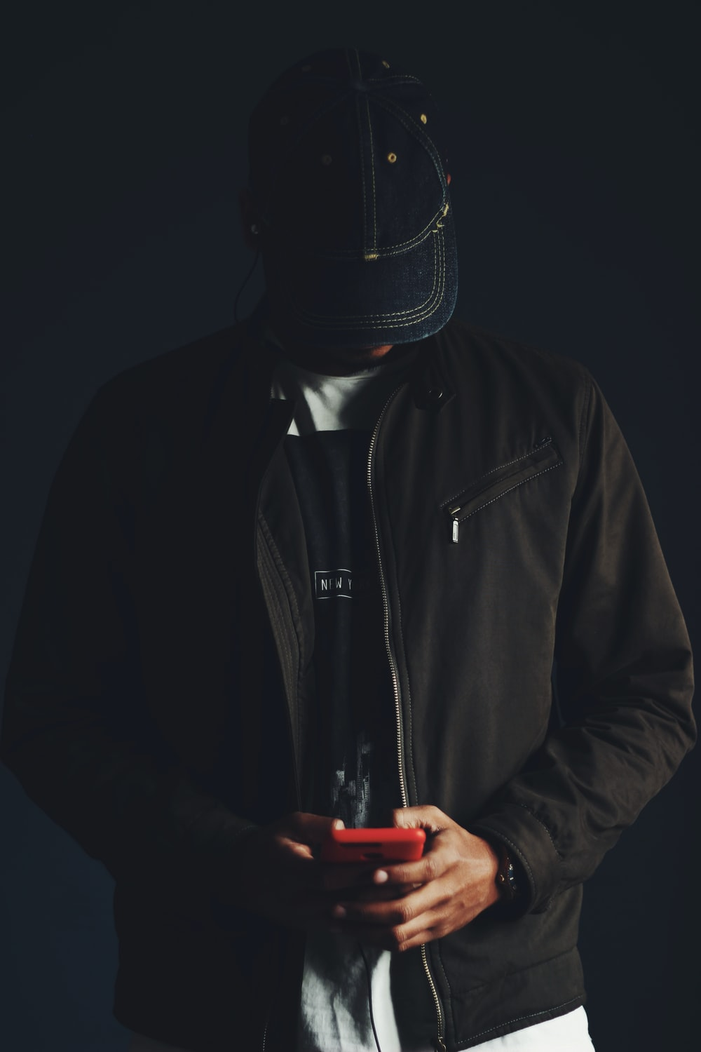 man in black zip up jacket wearing black mask
